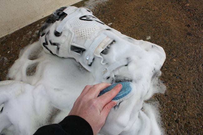 how to clean motocross boots with soap and a brush