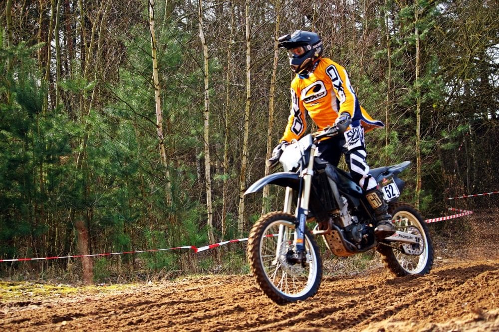 Standing on a dirt bike is a very stable position.